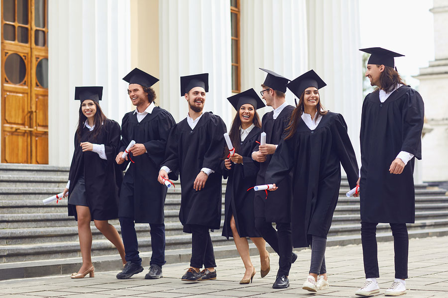 group of college graduates walking together