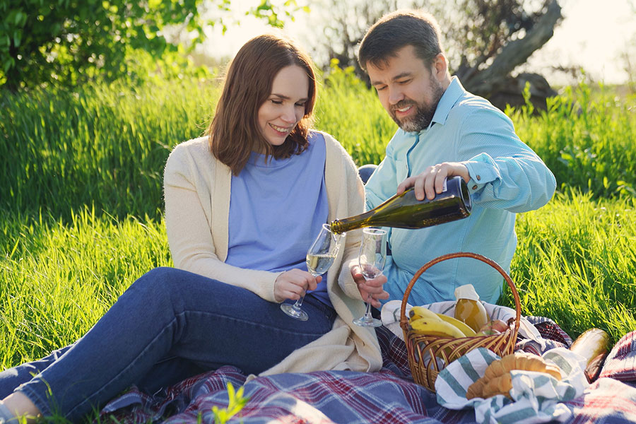 couple enjoying a lovely picnic outdoors