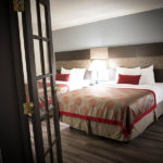 guest suite bedroom with two queen beds